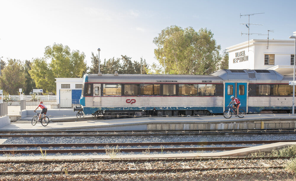 VR Sto Antonio, Portugal - Mountain bikers getting down from train at railway station, Algarve, Portugal