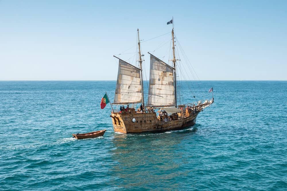 LAGOA PORTUGAL - Santa Bernarda Pirate Ship sailing along the coast on a daily touristic visit to the seashore caves.