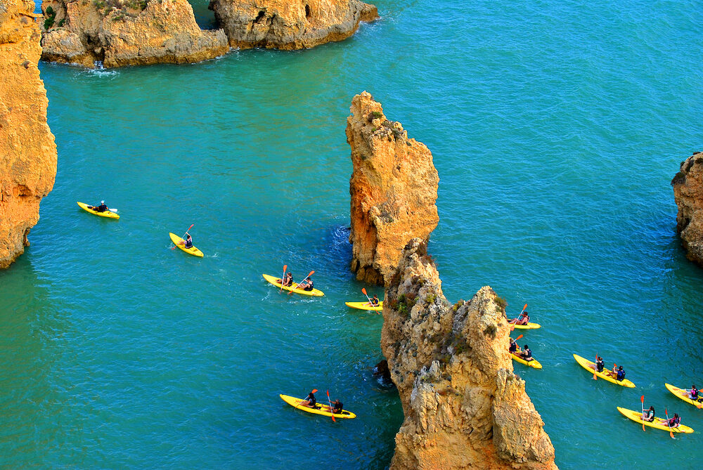 Ponta Da Piedade Algarve Portugal - : Tourists kayaking through the spectacular rock formations