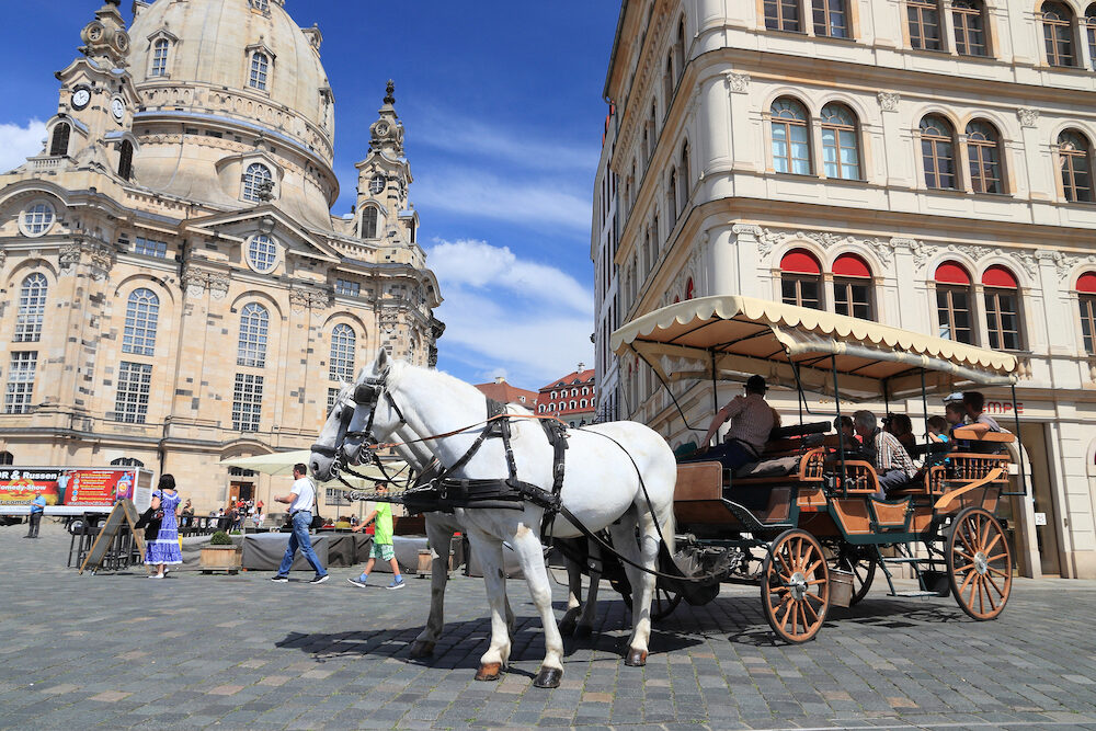 DRESDEN, GERMANY - Horse carriage ride at Neumarkt square in Altstadt (Old Town) district of Dresden, the 12th biggest city in Germany.