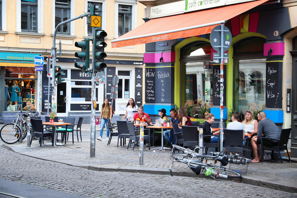 DRESDEN, GERMANY - People visit restaurants in Neustadt district of Dresden. Neustadt is a hip district of quirky restaurants and alternative shopping.