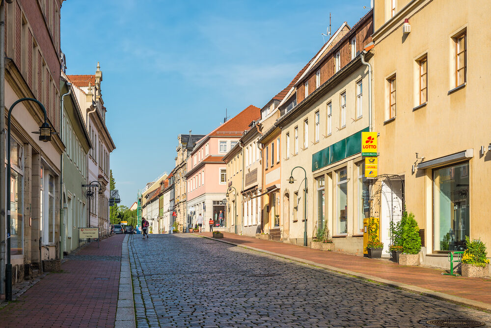 Wilsdruff, Germany - Street view with shops and residential buildings in the early morning in a small town Wilsdruff, a suburb of Dresden, Germany. Dresden is 14 km from the town.