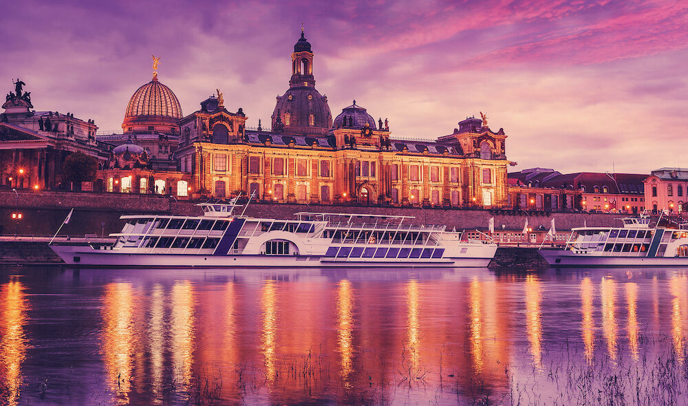 Wonderful Cityscape, The old town of Dresden with the river Elbe after sunset with colorful sky. Evening view of Academy of Fine Arts and Baroque church Frauenkirche cathedral. Creative image.