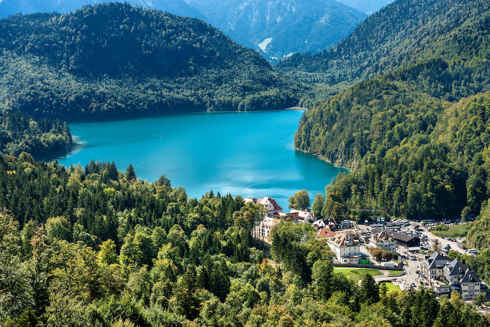 Alpsee - Alpine lake and the Hohenschwangau Village, Schwangau, Ostallgau district, Bavaria, Germany. It is located near the Neuschwanstein Castle and the Hohenschwangau Castle