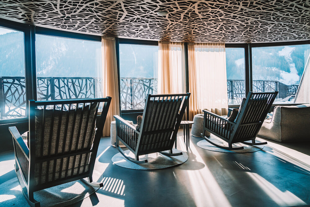 Alpina hotel, Saalbach. Austria. . Amazing SPA terrace interior design with mountain view. Comfortable chairs and sofas. Ski resort luxury hotel SPA.