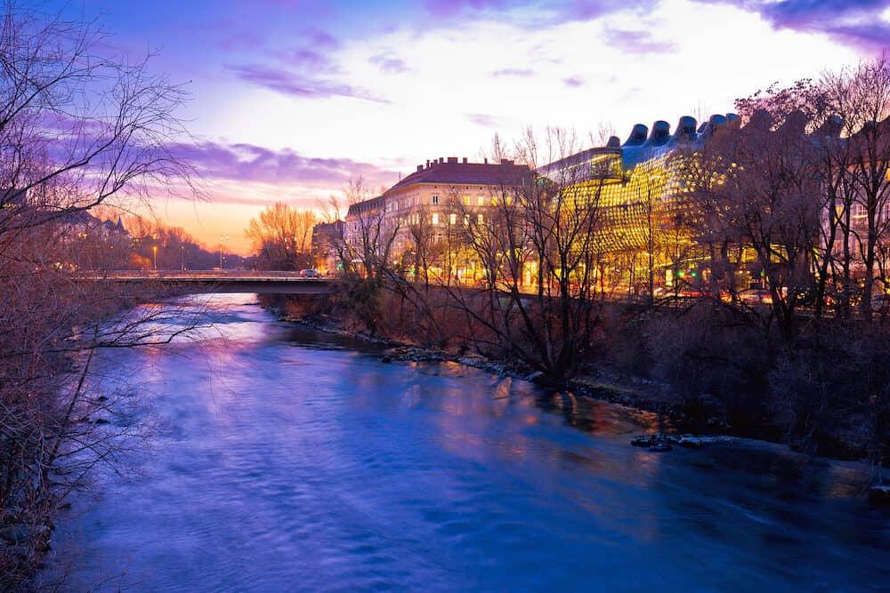 Mur river waterfront in Graz evening view, Styria region of Austria
