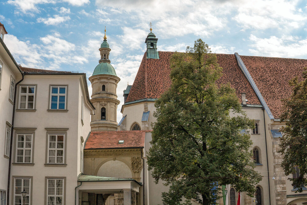 Graz. Austria. View of the Church of St. Catherine and the Church tower in Graz