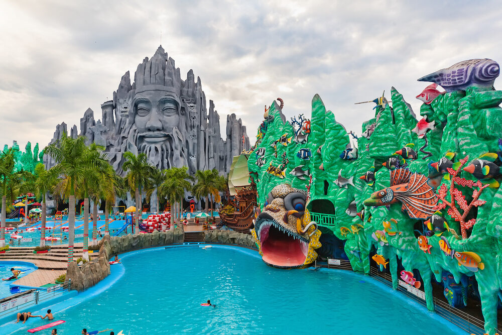 Ho Chi Minh city ( Saigon ) Vietnam - People in outdoor swimming pool in children water park and historical theme amusement park Suoi Tien - popular travel destination in Vietnam.