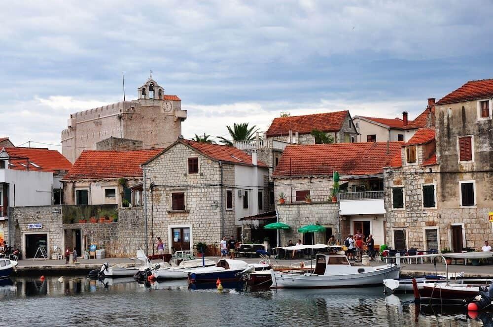 Vrboska Croatia -: Vrboska town houses and boats in Croatia