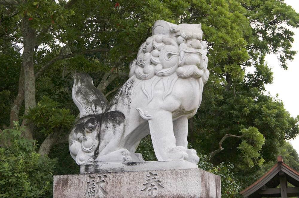 Picture of a typical huge Komainu (dog-lion like guardian) stone statue at the Izanagi Shrine on Awaji Island in Japan