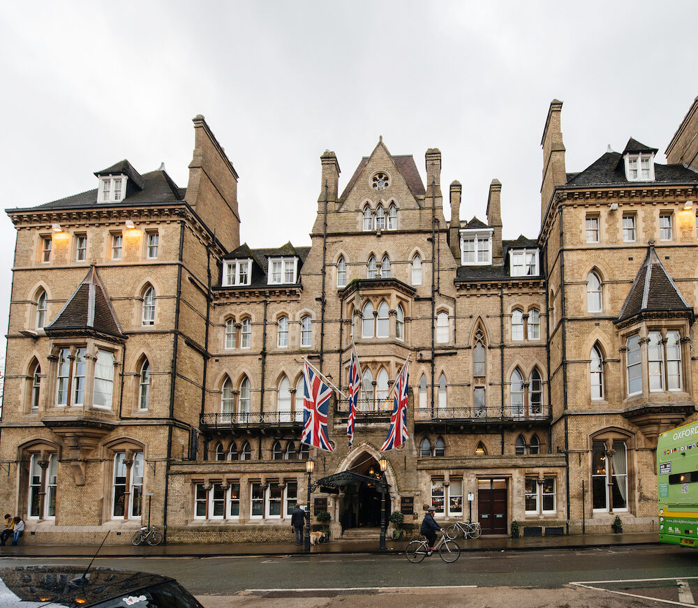 Oxford, United Kingdom - Macdonald Randolph Hotel in central Oxford Beaumont Street, at the corner with Magdalen Street, opposite the Ashmolean Museum and close to the Oxford Playhouse. The hotels architecture is Victorian Gothic in style.
