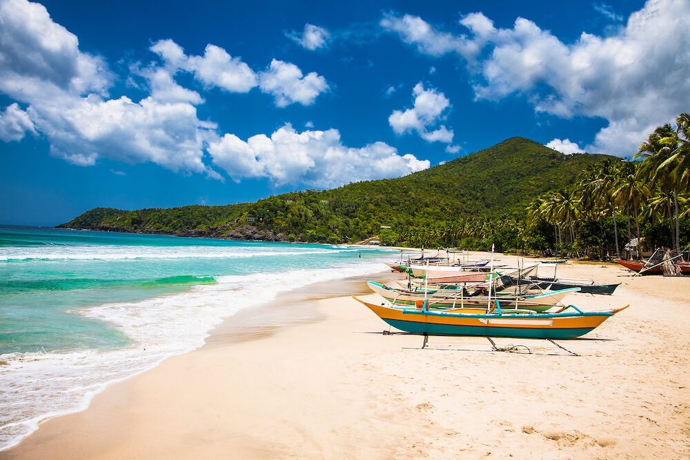 Traditional boats on Sabang beach, Puerto Princesa, Palawan island. Philippines .
