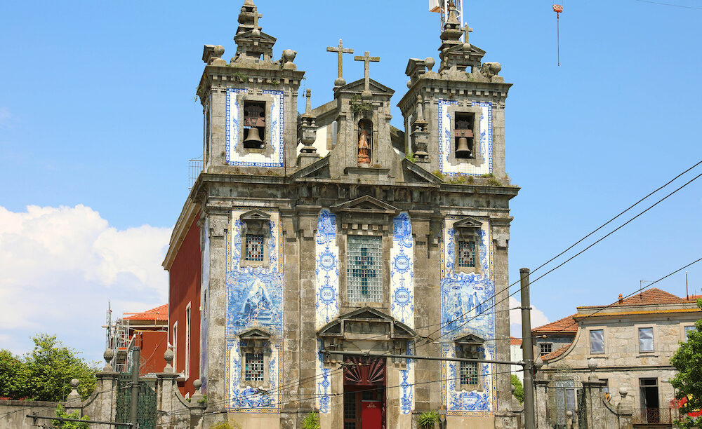 Church of Saint Ildefonso in Porto old town, built during the 17th century; the facade with two towers is completely covered with the traditional ceramics tile azulejos, Porto, Portugal