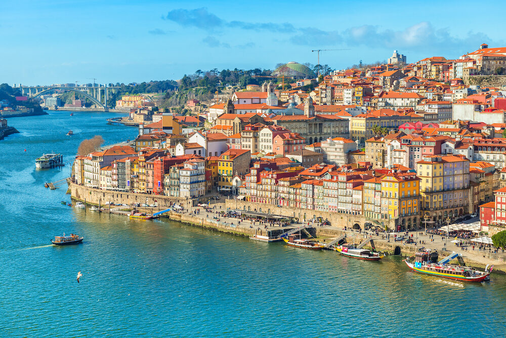 Cityscape of Porto (Oporto) old town, Portugal. Valley of the Douro River. Panorama of the famous Portuguese city. Popular tourist destination
