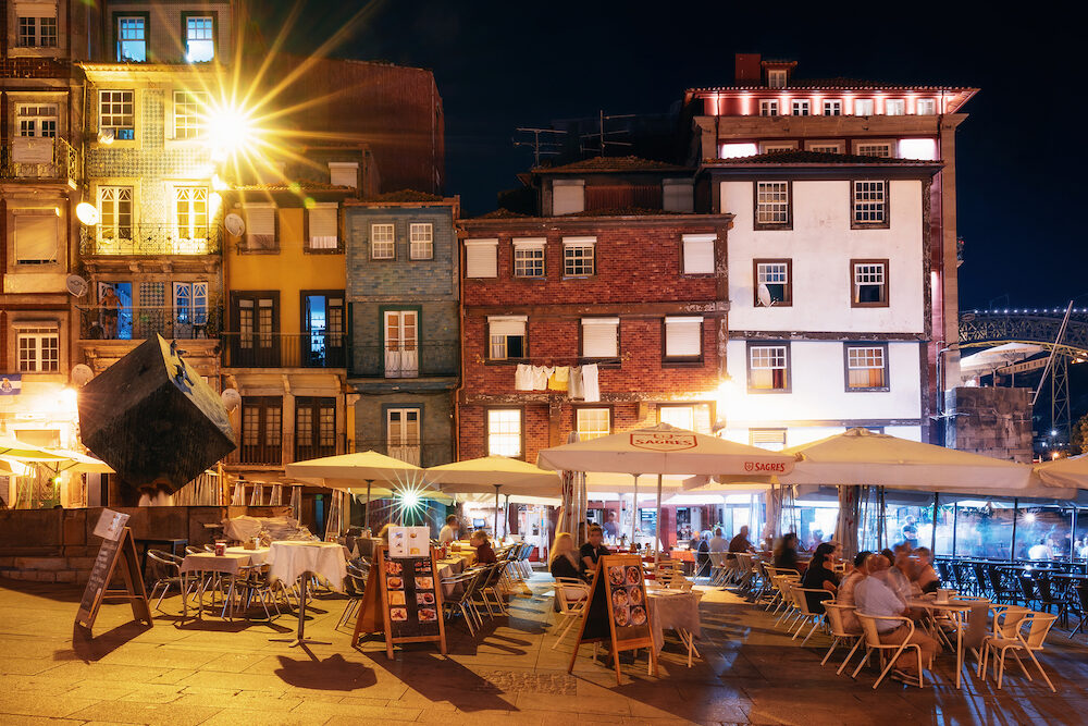 Porto, Portugal - : Porto, Nightlife on the crowded promenade of the Douro River with cafes and restaurants in Porto