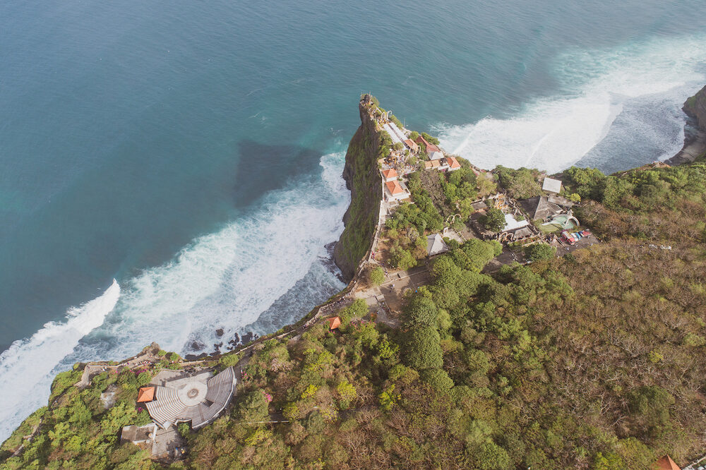 Aerial drone view of temple and beautiful Uluwatu clffs in Bali, Indonesia