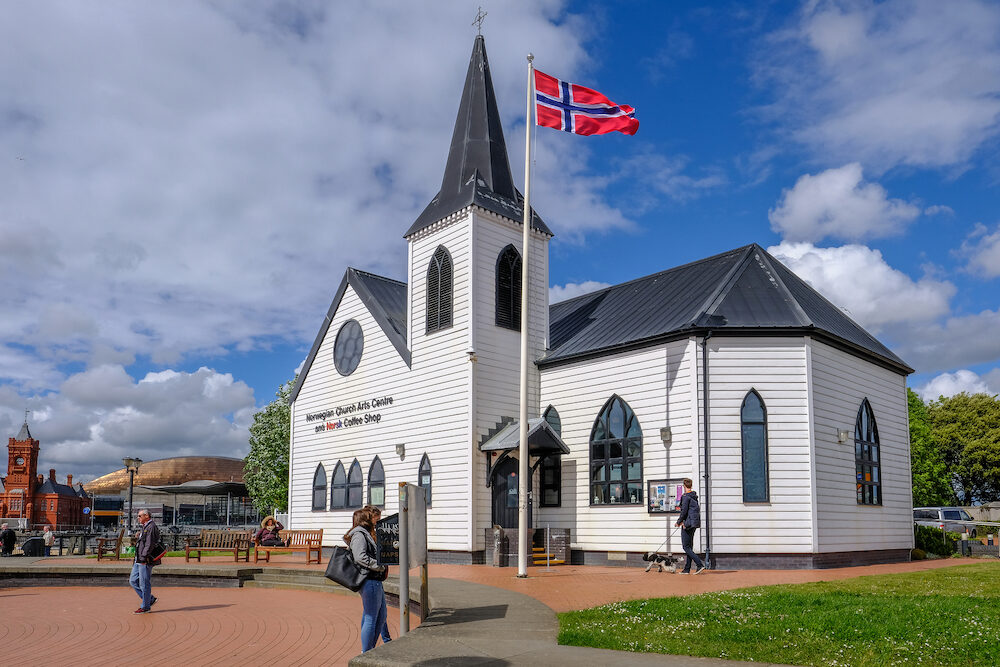 Cardiff Bay Cardiff Wales - Norwegian Church and arts centre with flag and people