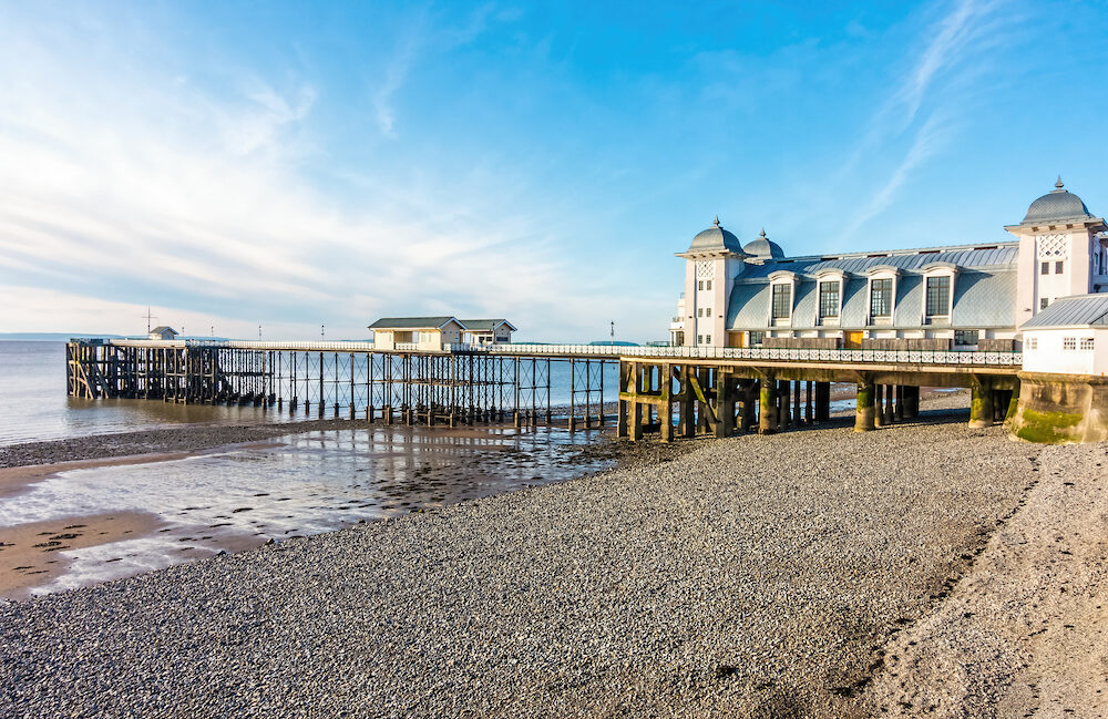Penarth Pier and pebble beach in summer.