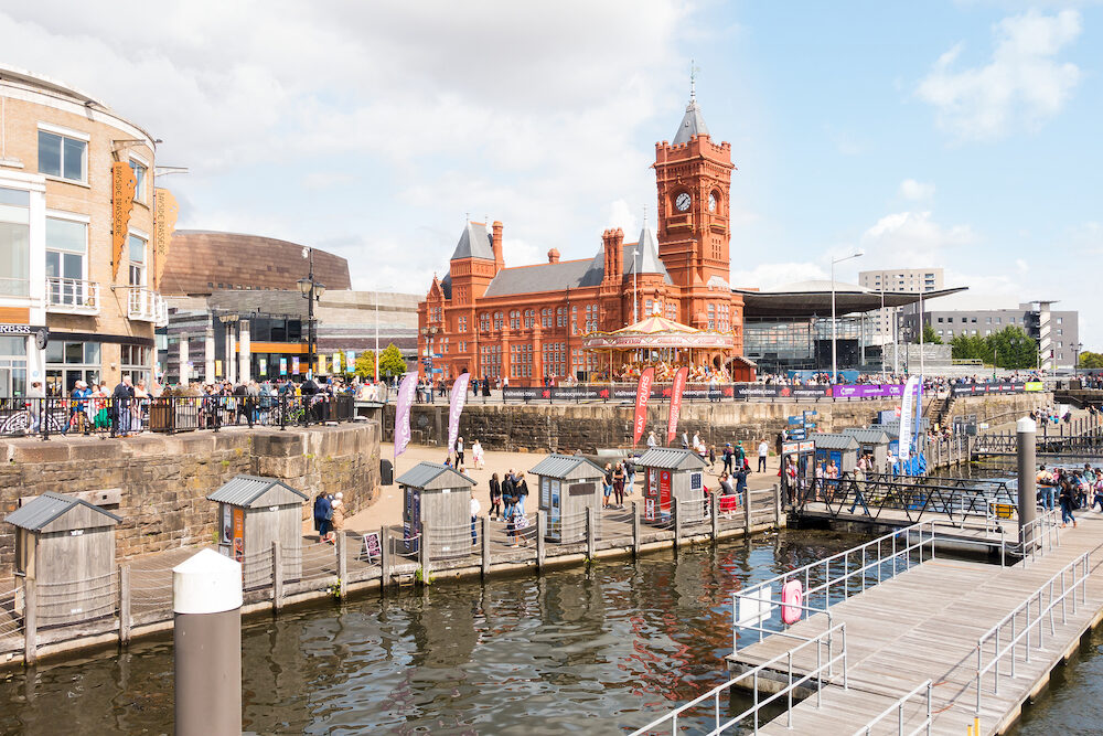 Cardiff, United Kingdom - People are enjoying a sunny bank holiday at the harbour festival while watching the Extreme Sailing Series Race.