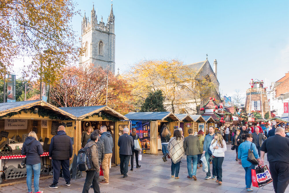 Cardiff Wales United Kingdom - People are visiting the Christmas Market in Cardiff City Centre on a sunny day