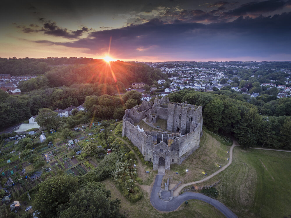 Editorial Swansea, UK - Sunset at Oystermouth Castle, a Norman stone castle in South Wales overlooking Swansea Bay on the east side of the Gower Peninsula near the village of the Mumbles.