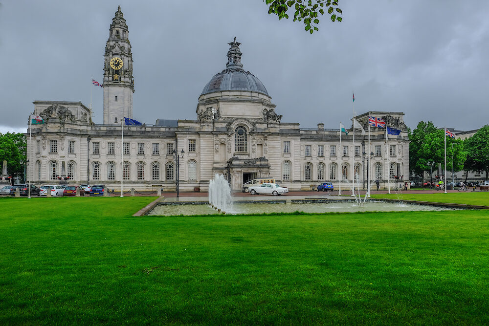 Cardiff, Wales -Town Hall with wedding cars waiting in front of this majestic building
