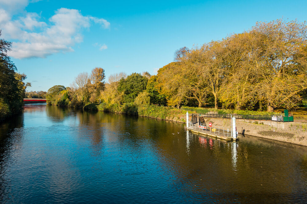View of the river taff public Bute Park and the water bus stop at the public and government owned Cardiff castle in autumn. Cardiff Wales UK