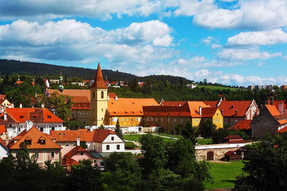 CESKY KRUMLOV CZECH REPUBLIC - Monastery yard on the Vltava river bank with a bell tower