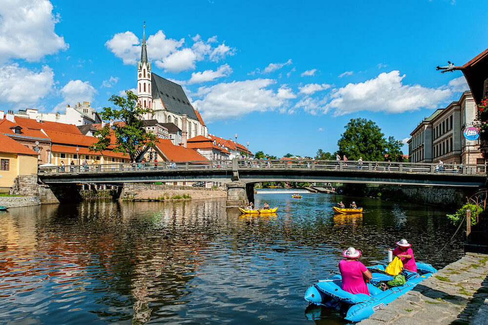 Cesky Krumlov, Czech Republic - beautiful view of a fragment of the embankment and the coastal area of the Vltava river.