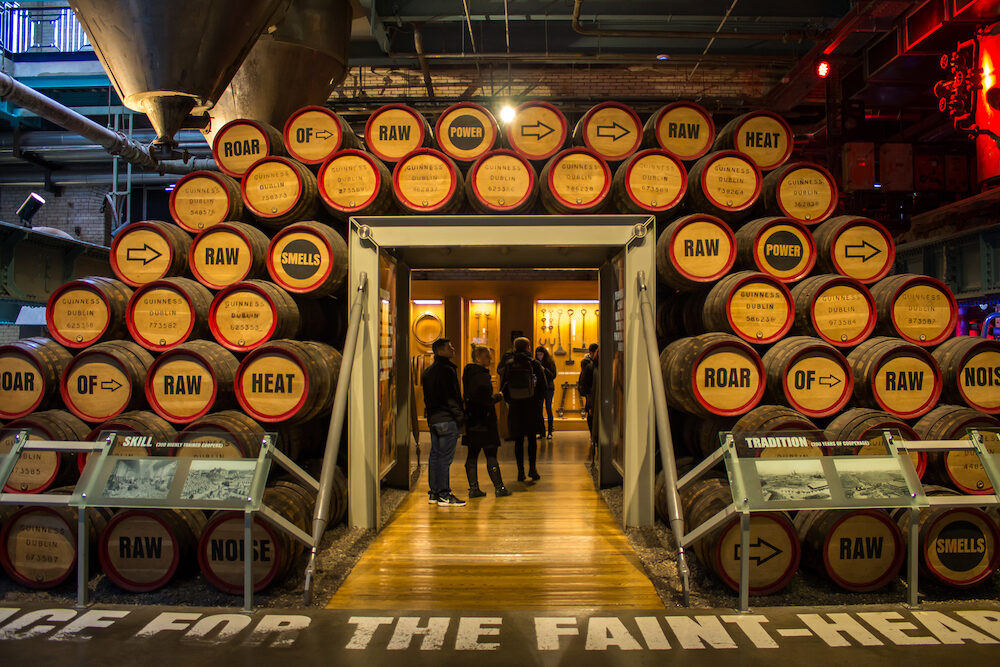 DUBLIN, IRELAND - People visiting the interior of the Guinness StoreHouse in Dublin. Wooden barrels of beer