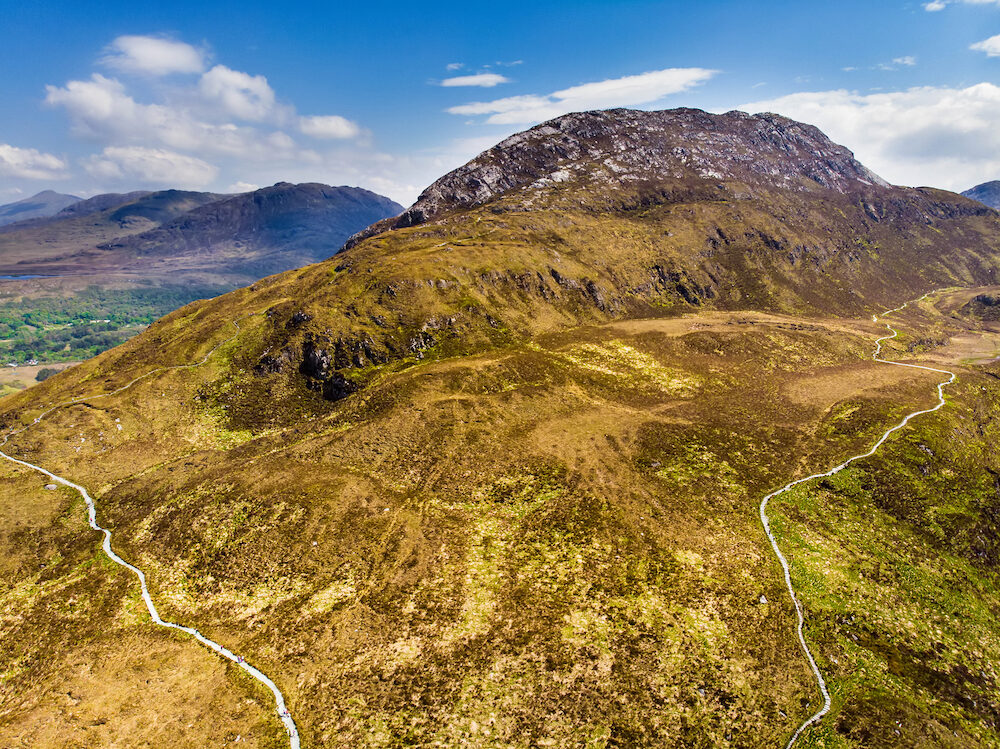 Beautiful view of Connemara National Park, famous for bogs and heaths, watched over by its cone-shaped mountain, Diamond Hill, County Galway, Ireland