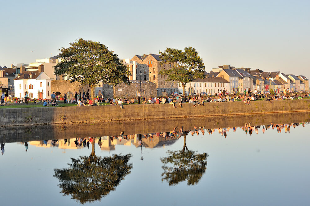 Spanish Arch Galway Ireland - lots of people enjoying a sunny day