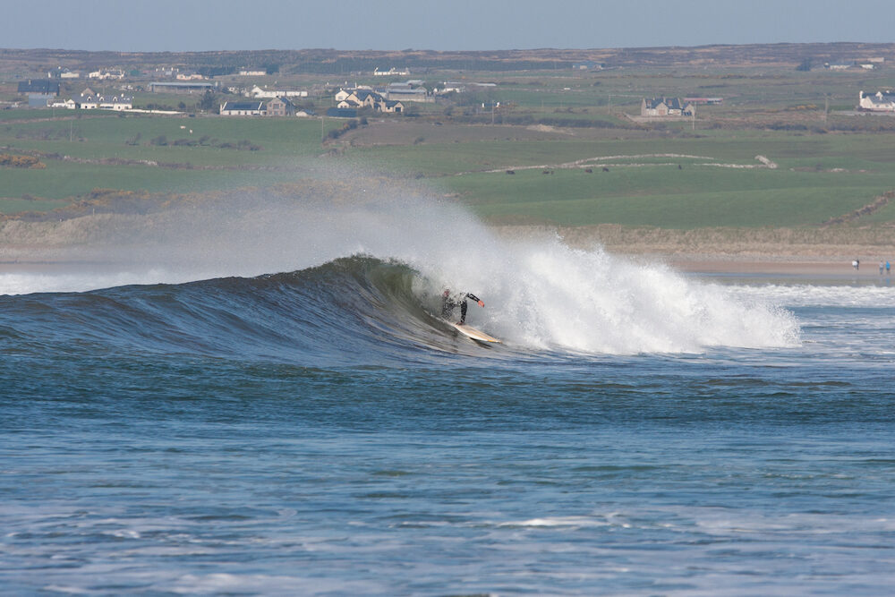 Surfing the Waves off Lahinch beach Ireland