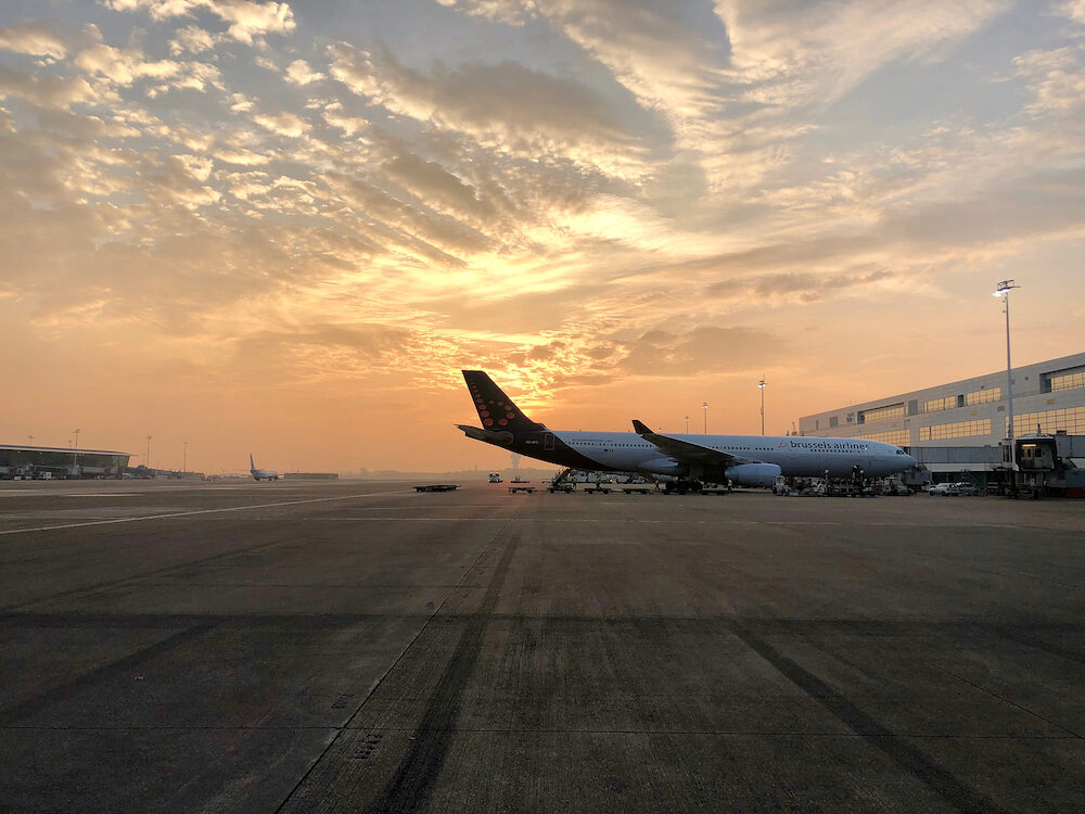 Sunrise over passenger airliners parked at Brussels Zaventem International Airport in Brussels, Belgium.