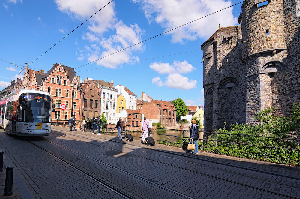 Ghent, Belgium- View of a tram passing on railways in old part of the city Ghent. Spring morning view