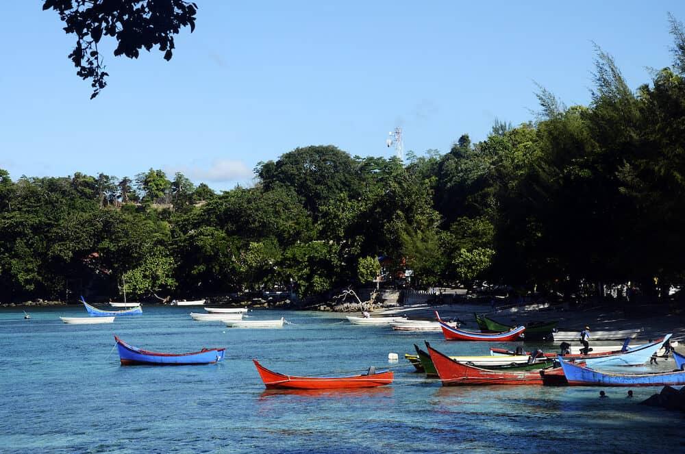 Sea coast landscape and colored boats in Pulau Weh island, sumatra, indonesia