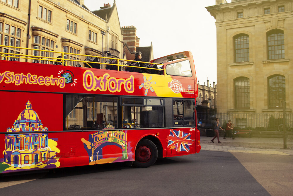 Oxford, UK - Red touristic buss in street Tourism