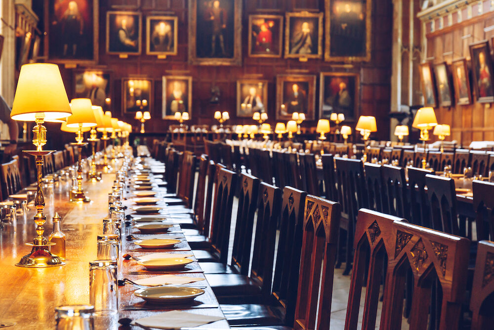 OXFORD, UK - Table set for dinner at The Great Hall of Christ Church, University of Oxford. The Hall was replicated at film studios as the grand dining hall at Harry Potter's Hogwarts school.