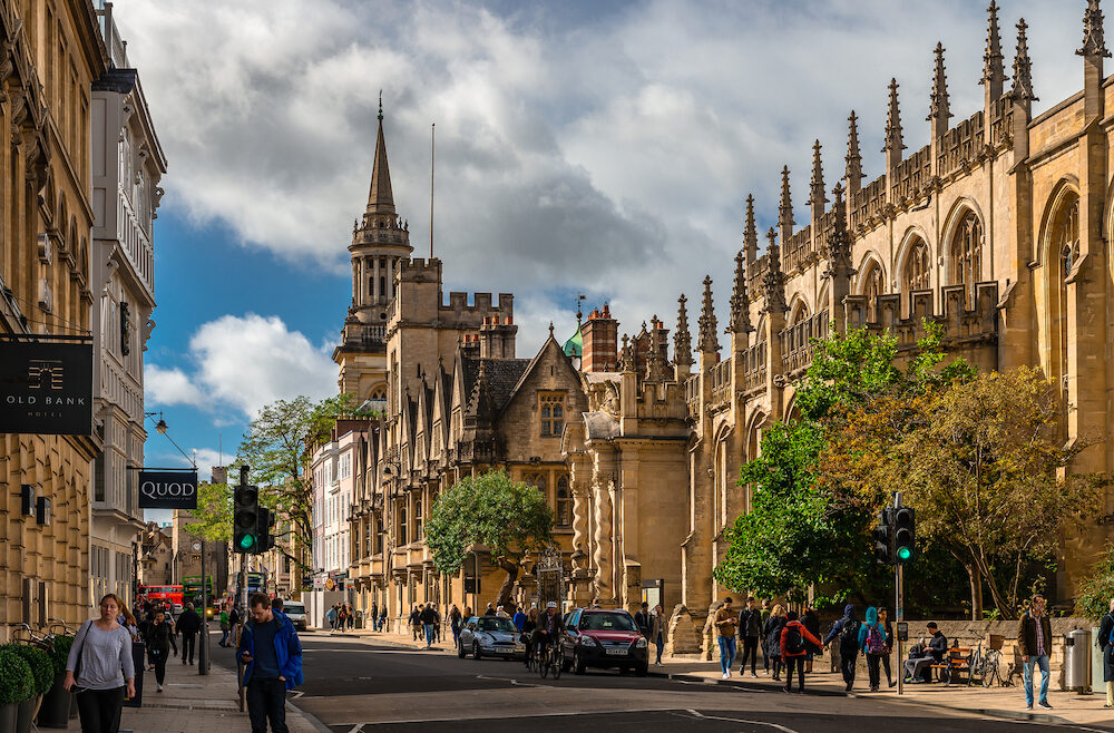 Oxford / UK - View of the High Street with the University Church of St Mary the Virgin and All Saints Church, now the library of Lincoln College.