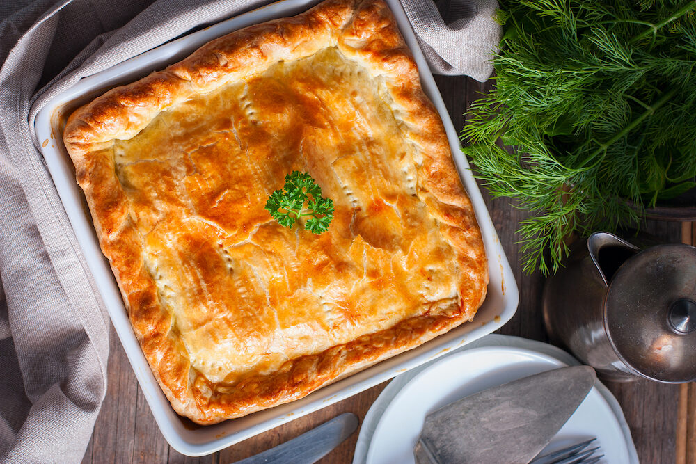 Puff pastry pie with chicken, potatoes and onions,