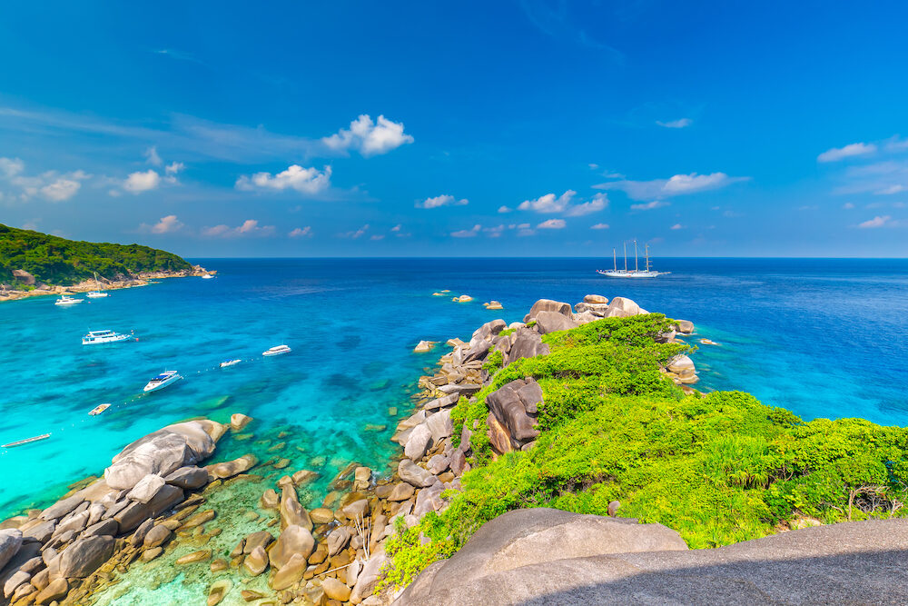 Similan Islands Beautiful tropical sandy beach and lush green foliage on a tropical island ,thailand