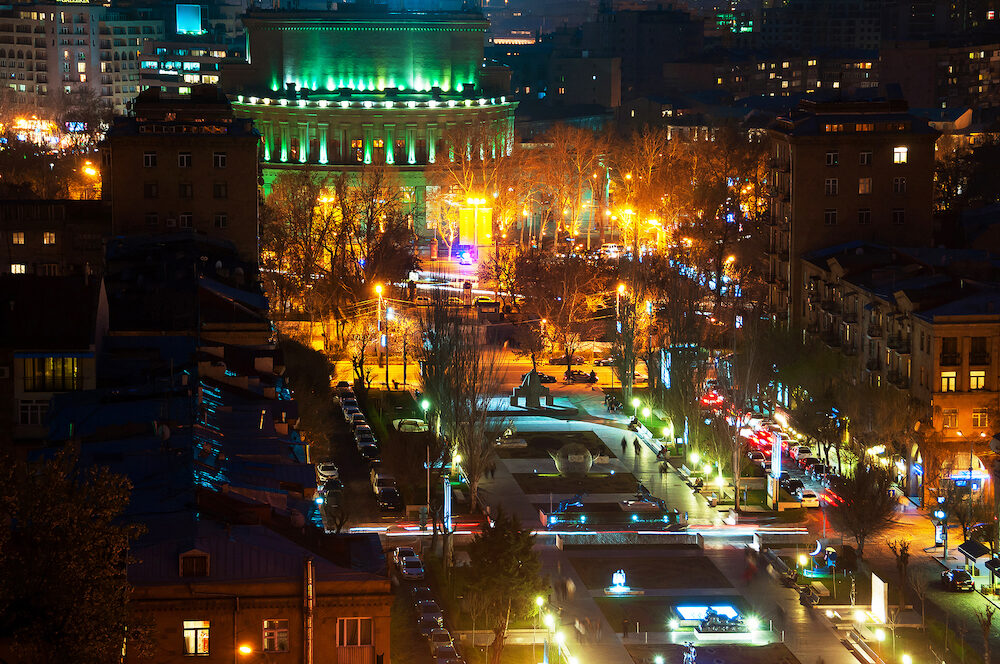 Night in Yerevan Armenia. Nightlife with people and car traffic in the capital of Armenia