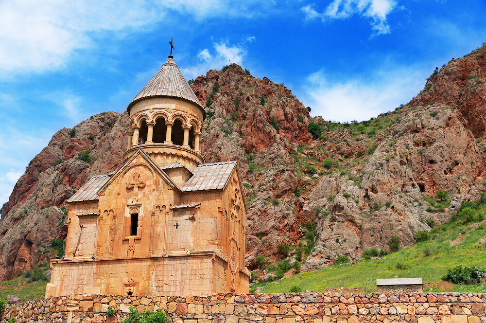 Scenic Novarank monastery in Armenia. against dramatic sky. Noravank monastery was founded in 1205. It is located 122 km from Yerevan in narrow gorge made by Darichay river nearby city of Yeghegnadzor