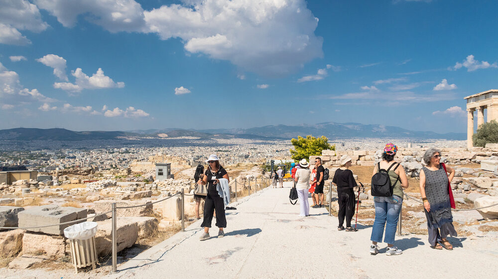 ATHENS, GREECE - Group of people walking in Monastiraki Square in Plaka, Athens Greece.