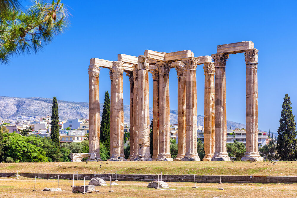 Temple of Olympian Zeus, Athens, Greece. It is one of the top landmarks of Athens. Famous Ancient Greek ruins in the Athens center in summer. Scenic panorama of remains of the antique Athens city.