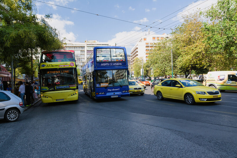 ATHENS, GREECE- Tourist sightseeing double decker busses in Athens, Greece. Athens is the capital and largest city of Greece.