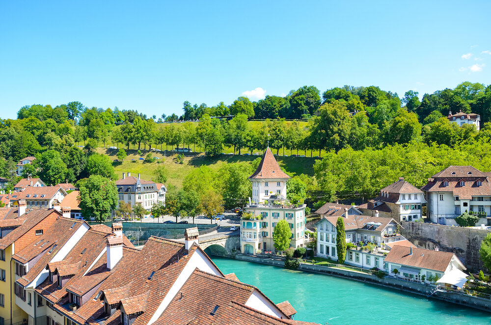 Beautiful cityscape of Swiss capital Bern. Old town located along turquoise Aare River. Historical buildings. Photographed in summer season. Tourist attractions. Switzerland city