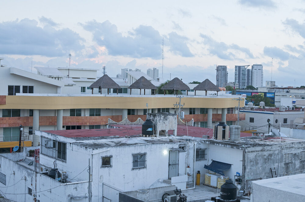 CANCUN MEXICO - : A rooftop view at sunrise reveals the urban development of the city of Cancun in the early morning light