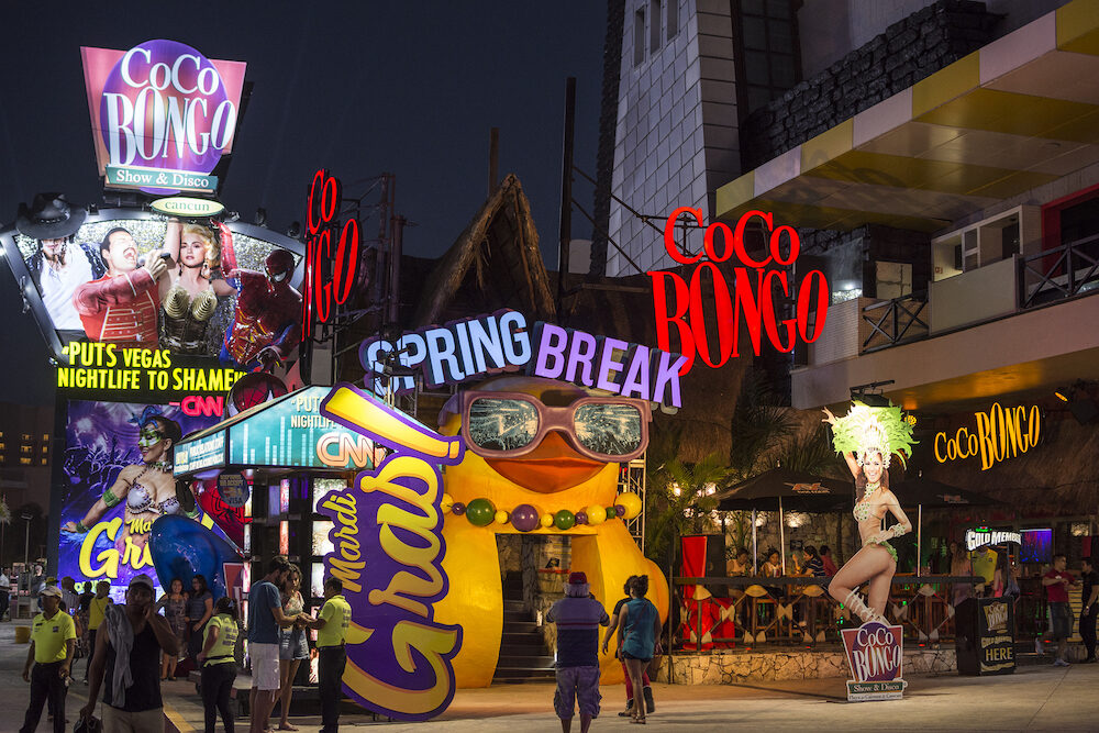 CANCUN MEXICO - Cancun's premiere nightclub Coco Bongo lights up the night with colorful displays promoting Spring break.