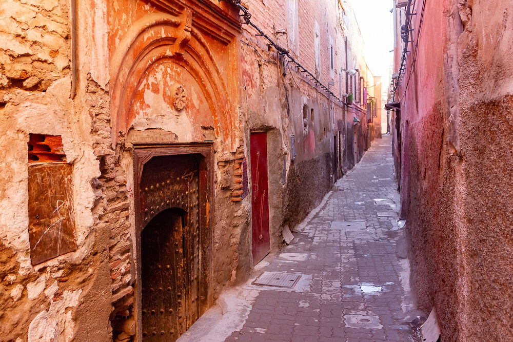 Colorful ancient old and narrow street in medina of Marrakech, Morocco, Africa